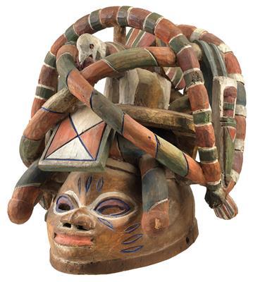 Yoruba,-Nigeria--A-'Gelede-mask_-with-tall,-complex-crest.
